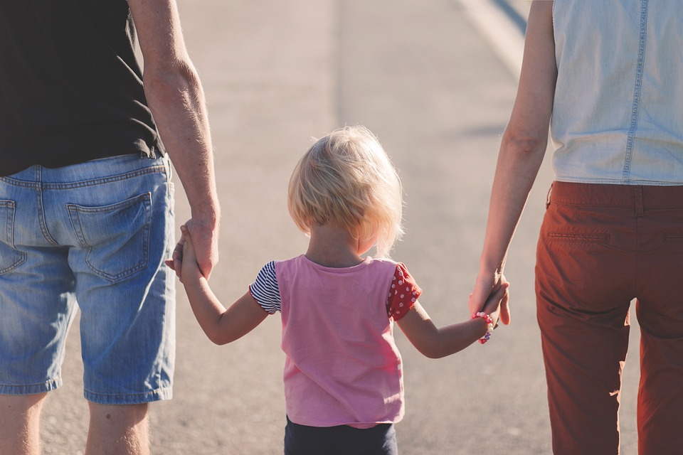 hand-in-hand with child
