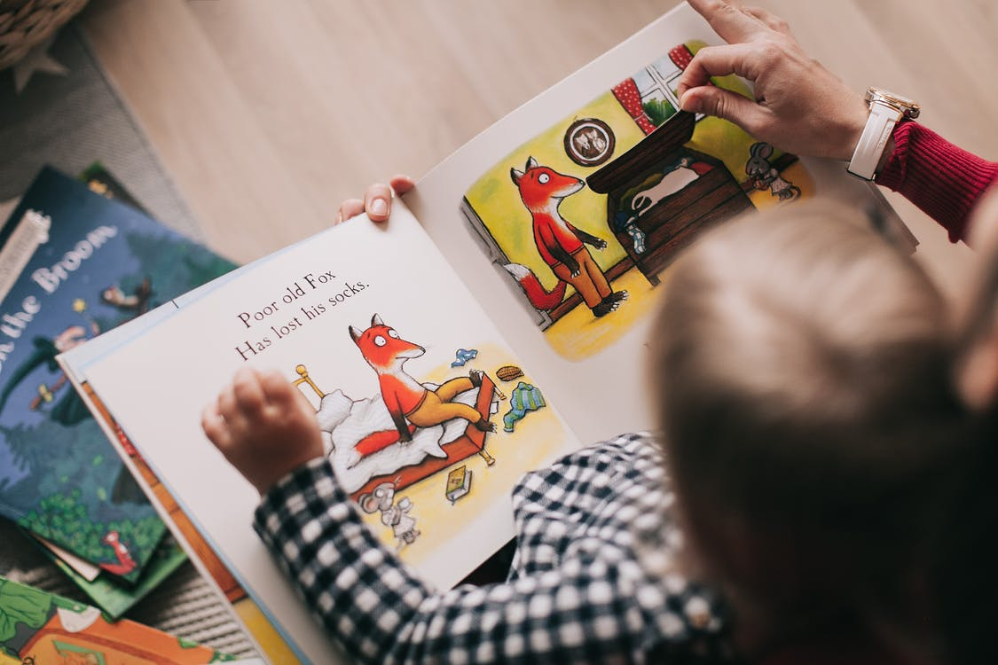 reading picture book to child