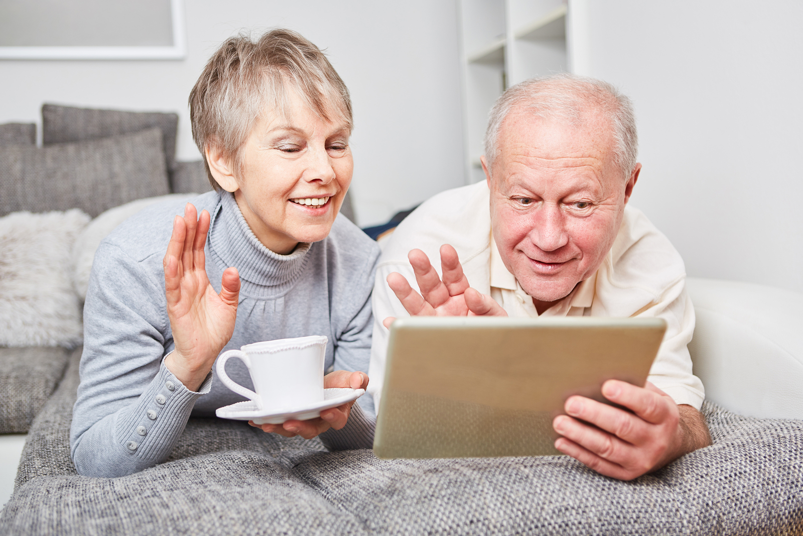 grandparents using tablet device
