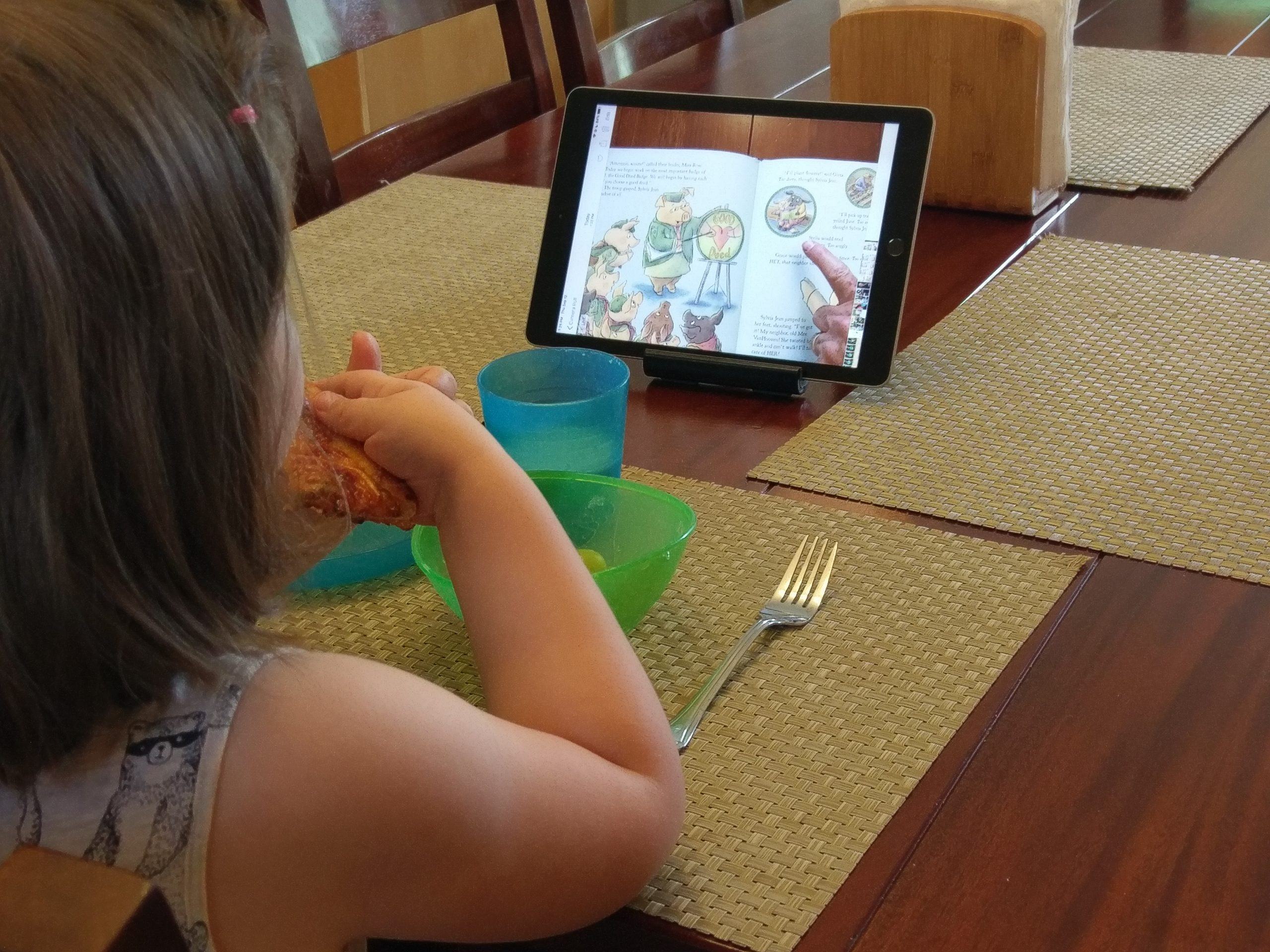 Child watching iPad at Breakfast