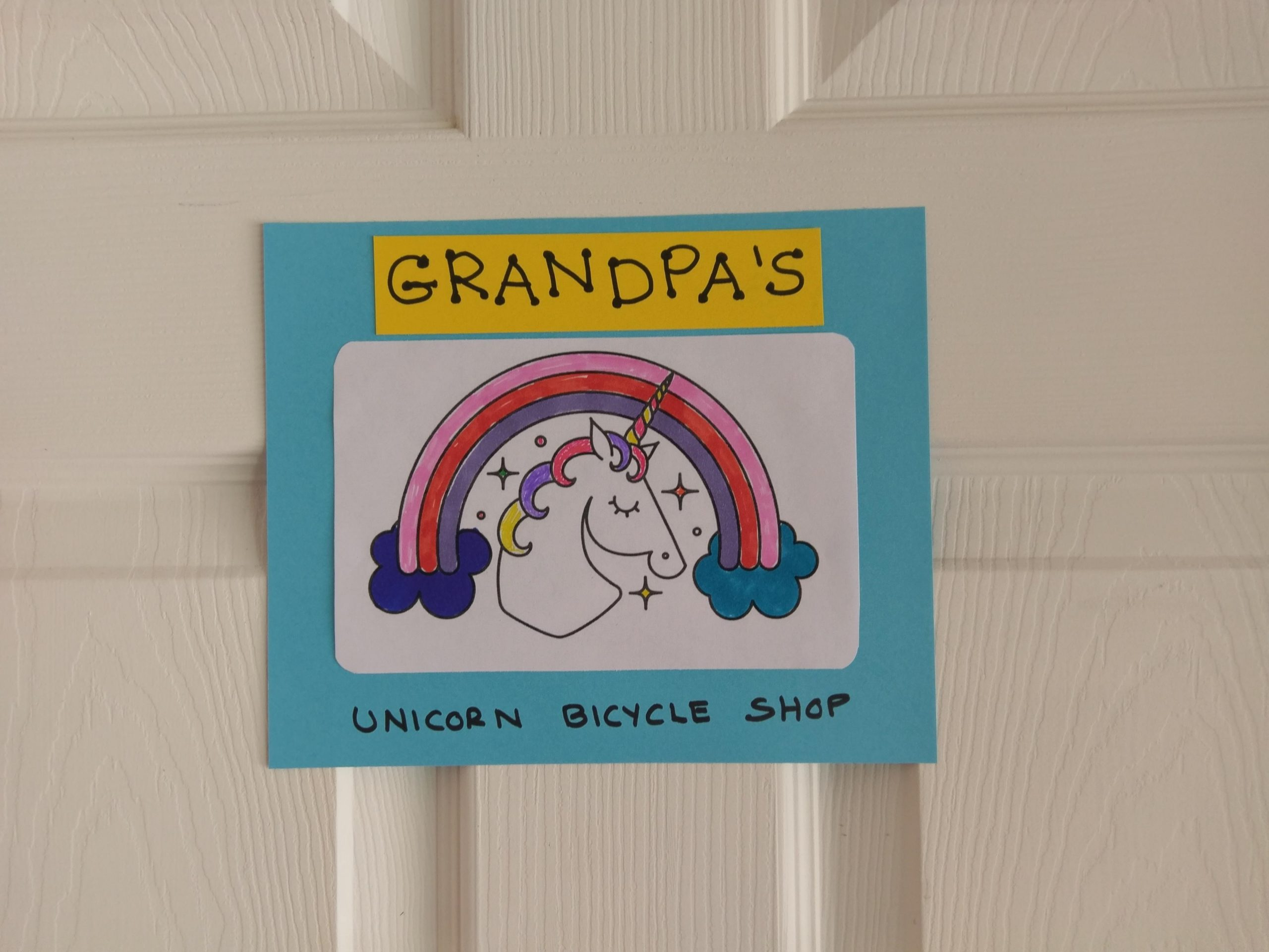 Sign for Grandpa's Unicorn Bicycle Shop