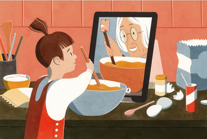 grandmother on ipad cooking with child